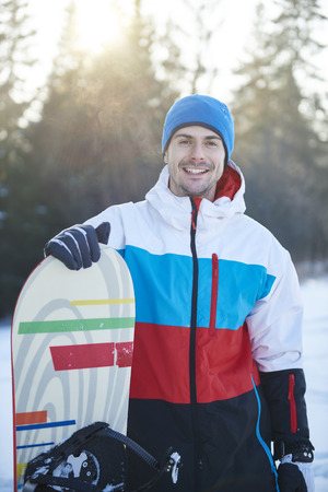 Portrait of man with snowboard