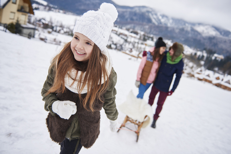 Snowy activities sharing with family Stock Photo