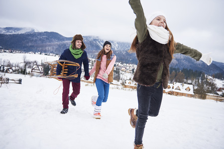 Family having winter activities outdoors Stock Photo