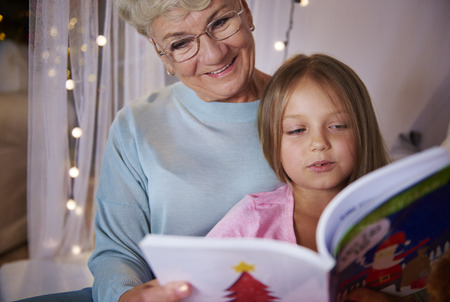 My grandmother teaching how to spelling Stock Photo