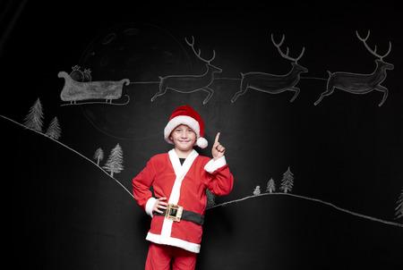 Portrait of boy in santa claus costume
