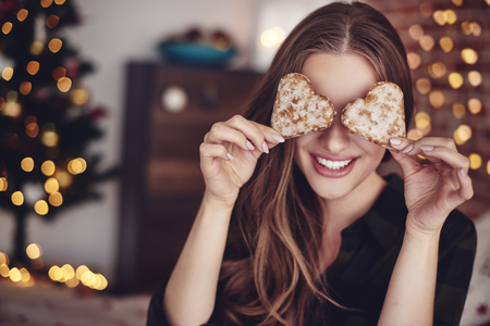 Two heart-shaped biscuits in front of eyes Stock Photo