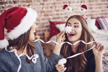 Female friends amusing each other Foto de archivo