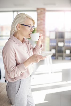company: Employee having a coffee at work