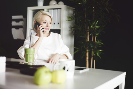 Business person discussing business while phone conversation Stock Photo