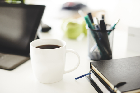 Shot of office Supply with mug of coffee