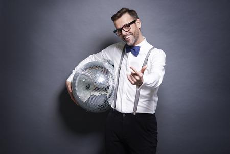 Man holding a disco ball