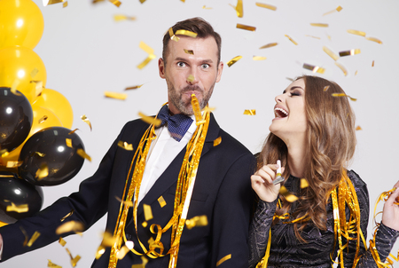 Couple with horn blower partying Stock Photo - 88749302