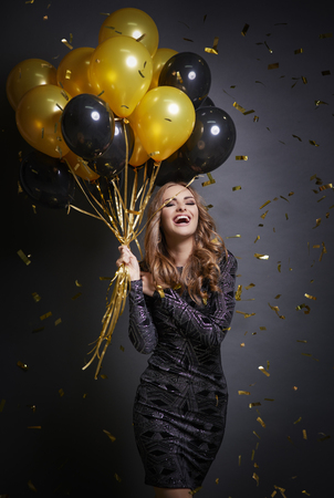 Happy woman with balloons celebrating her birthday Stock Photo