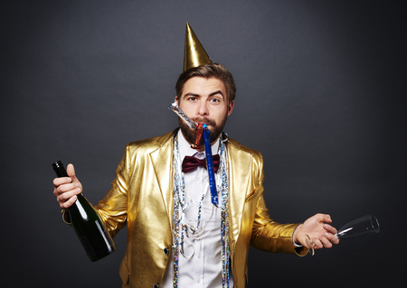 Man with champagne greeting new year Stock fotó
