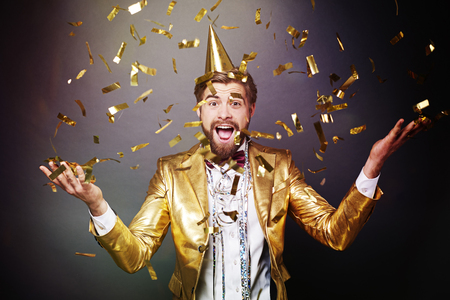 Portrait of man among confetti Stock fotó