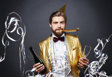 Man celebrating new year with champagne
