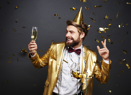 Man with champagne flute greeting new years day