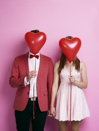 Unrecognizable couple with balloon holding hands  Stock Photo