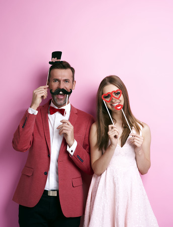 Couple with funny valentine's masks Stock Photo - 89280364