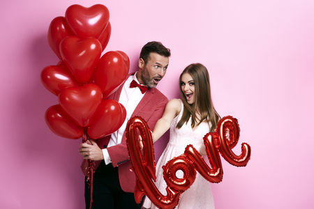 Couple make preparations for Valentine's party Stock Photo - 89403880