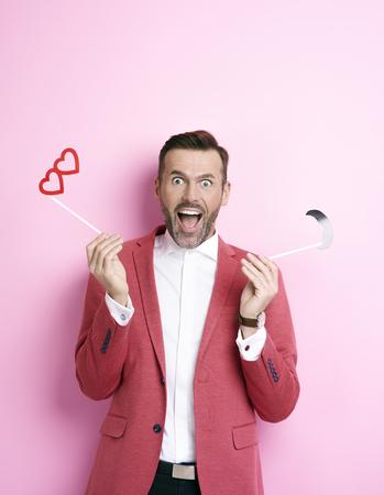 Screaming man  holding valentine monocle  Stock Photo