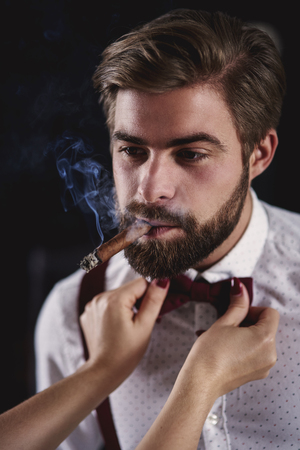 Handsome man with cuban cigar flirting