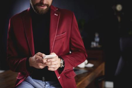Unrecognizable businessman using smartphone in office Stock fotó - 89403766