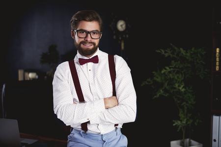 Portrait of cheerful entrepreneur at his office  Banco de Imagens