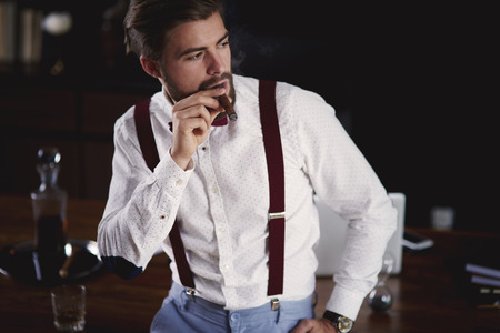 Businessman smoking a cuban cigar