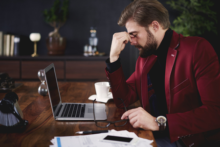 Exhausted businessman at his office