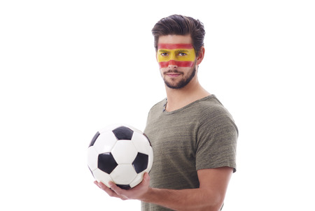 Front view of devoted spain supporters with soccer ball  Stock Photo