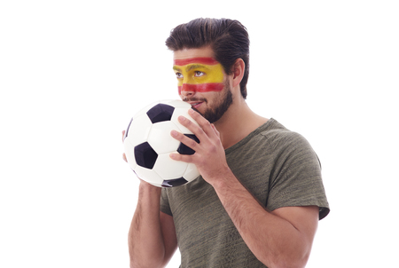 Nervous soccer fan with soccer ball looking ahead   Stock Photo