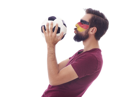 Enthusiast of soccer kissing a soccer ball