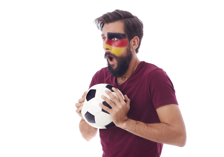Shocked soccer fan with soccer ball