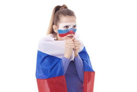 勝利のために祈って国旗とロシアの女性ファン 写真素材