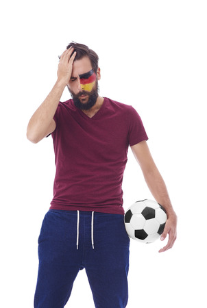 Disappointed soccer fan with soccer ball Stok Fotoğraf - 90300195