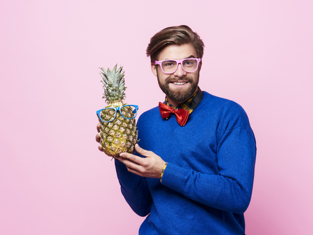 Man and pineapple with sunglasses