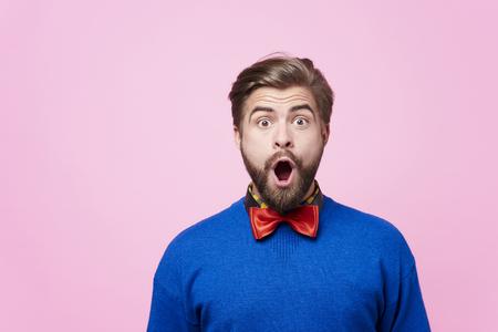 Portrait of shocked man at studio shot   Banco de Imagens