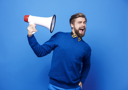 Portrait of man holding a megaphone  Stock Photo