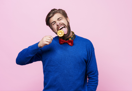 Funny man licking a lollipop