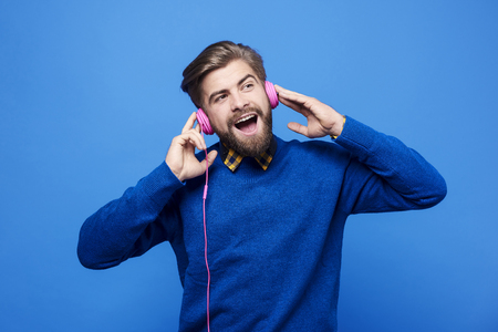 Man listen to music by headphones and singing  Banco de Imagens