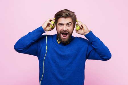 Front view of screaming man with headphones