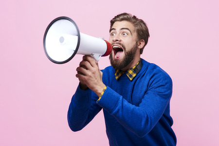 Man yelling into a megaphone  Stockfoto