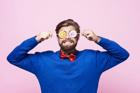 Funny man with lollipops on eyes  Stock Photo