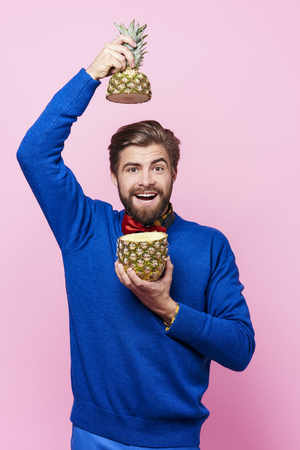 Man posing with a pineapple Stock Photo