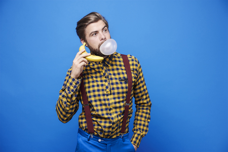 Man using banana as a phone