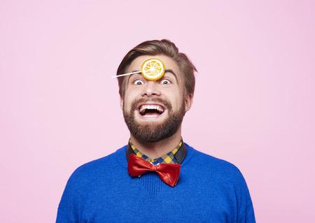 Bizarre man with lollipop having a fun Фото со стока - 90406860