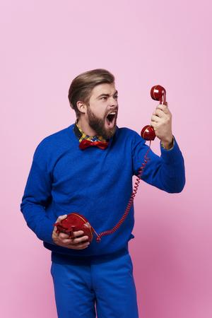 Furious man arguing while phone call