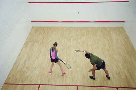 Two friends playing squash together   Stock Photo
