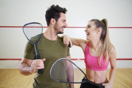 Squash couple flirting on court