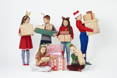 Surprised group of children watching christmas present
