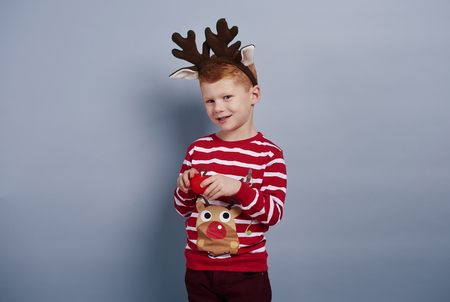 Cute boy looks like reindeer Stock Photo