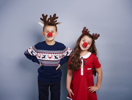 Cute girl and boy wearing reindeer costume