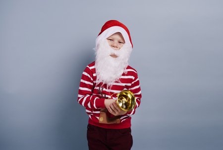Child wearing santa hat and beard
